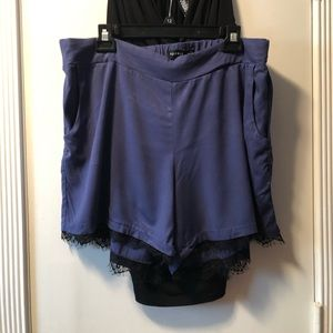 Royal blue shorts with black lace trim